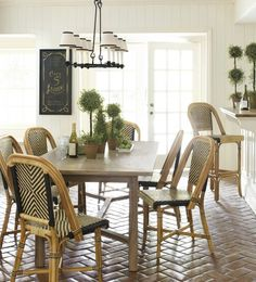This airy breakfast room mixes vintage-inspired cafe chairs with a clean-lined dining table