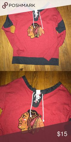 Blackhawks off the shoulder sweatshirt Great condition except slight fading on decal on front. Tie up enclosure. Off the shoulder. Size small. Tops Sweatshirts & Hoodies