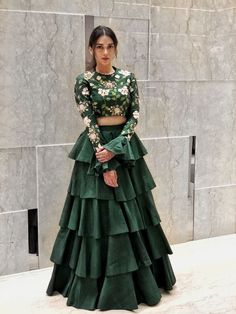 Looking for Beautiful bottle green lehenga with bell sleeved blouse and floral print along with a layered lehenga skirt? Browse of latest bridal photos, lehenga & jewelry designs, decor ideas, etc. Party Wear Indian Dresses, Designer Party Wear Dresses, Indian Gowns Dresses, Dress Indian Style, Indian Fashion Dresses, Indian Wedding Outfits, Indian Designer Outfits, Indian Outfits, Indian Designers