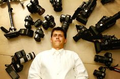 http://abundantmoments.com/  groom surrounded by cameras