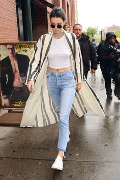 Kendall Jenner rocks a white tee and Citizens of Humanity jeans, paired with a striped coat, silver choker and round sunnies. See more of the model's best off duty looks here: