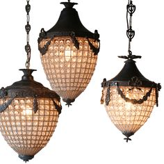 """The Eloquence collection of antique reproduction furnishings reflects the Old World glamour of classic European design. The Chateau chandelier's faceted glass beads illuminate a bedroom, dining room, or entryway with regal elegance. In the form of a vintage lantern, this light fixture features a mixed metal frame for a timeless aesthetic and subtly eclectic vibe. Available in: Small (10""""W x 10""""D x 15""""H) and Large (13""""W x 13""""D x 20""""H); Chain: 3'L. Includes..."""