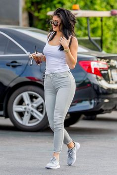 Kylie Jenner wearing Nike Roshe Run Metallic Platinum Sneakers, Rolex Oyster Perpetual Day Date Gold-Diamond Watch, Givenchy Mini Pandora Bag in Gray, James Perse Daily White Tank and 7 For All Mankind Slim Illusion Jeans in Lunar Rock