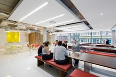 Exposed ceiling with suspended rafts and lighting. Corporate Interiors, Corporate Design, Office Interiors, Industrial Office Space, Work Cafe, Exposed Ceilings, Commercial Office Design, Ceiling Treatments, Steel House
