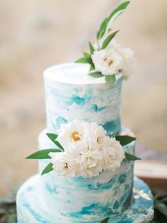 Blue marble flower topped wedding cake: http://www.stylemepretty.com/little-black-book-blog/2017/01/02/rustic-elegant-montana-ranch-wedding/ Photography: Simply Sarah - http://simplysarah.me/