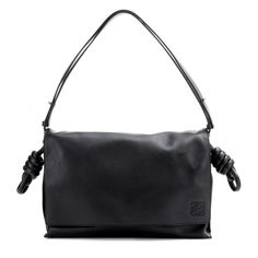 Loewe - Flamenco Flap leather shoulder bag - Loewe's 168-year old reputation of impeccable craftsmanship shines through with every piece. The latest style we're lusting after is the 'Flamenco Flap', a functional black leather shoulder bag that'll carry your essentials with ease, as well as a spare pair of ballerinas - now that's practicality. Adjust the strap for a longer length when on the go, making sure to show off the intricate knot detailing and hand-painted edges. seen…