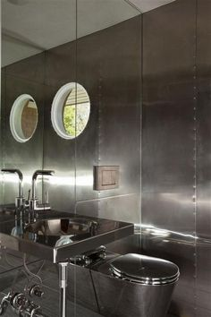 I could almost believe I was on a yacht from a century ago in this bathroom with its metal-clad walls. | japanesetrash.com