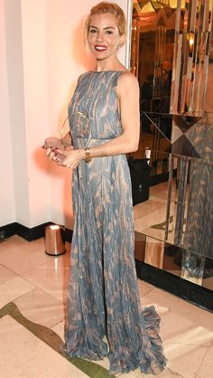 SIENNA MILLER in a pleated, pastel Valentino dress and coordinating clutch at the Harper's Bazaar Women of the Year Awards in London. David M. Benett/Getty Updated: Thursday Nov 05, 2015