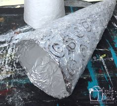 remove the styrofoam cone from the tinfoil and hot glue Christmas Tree