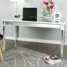 "Handcrafted mirrored desk with white trim.  Product: DeskConstruction Material: Wood and mirrored glassColor: Silver and whiteDimensions: 30"" H x 59"" W"