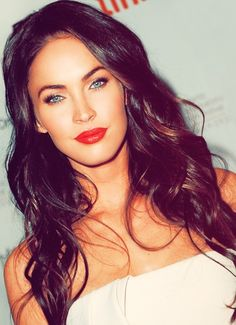 Pretty Megan Fox. Love the bouncy black wavy hair, highlights and red lips, her blue eyes pop too!