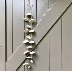 Blij om dit item uit mijn shop te delen: Beautiful handmade ceramic mobile, windchime or wallhanging with three strands with pure white porcelain circles. Handmade Ceramic, Pure White, White Porcelain, Strands, Wind Chimes, Etsy Shop, Ceramics, Pure Products, Outdoor Decor