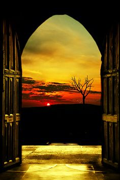 Sunset through arched doors