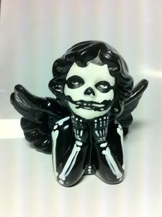 Paint a skeleton onto a Dollar store figure! Love this idea