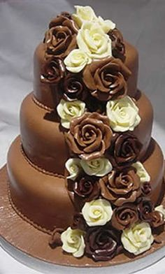 A switch the colors the cake white the flowers chocolate and some white