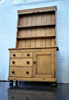This old Victorian pine dresser is a real beauty!  Having spent most of its life in an old florist shop, it has that deep rich patina that only comes from years of use.  It was a little wonky here and there too! However, after some gentle restoration ensuring all the  character remains, it is now fully waxed, tightened and ready for service once more!  Dimensions: Total height 203cm. Bottom 122cm width x 86cm height  / Top 109cm width x 117cm height
