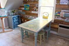 Maybe put our table like this in the school room.  Art & Craft Studio - Previously Just a Bonus Room eclectic home office