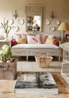 French Country | Cushions in a mixture of Kate Forman's printed linens.  Love the textured wall, and aged patina on wood pieces.