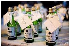Miniature liquor bottles make awesome wedding favors!  Name tags tied on with table assignment.