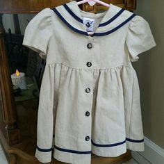 ⚓2T boutique sailor dress The most adorable lil' sailor dress ever!  55% linen 45% cotton. Made in the good ol USA!  Cream and navy blue striped with 5  lil gold anchor buttons in front and 2 in back. Like new condition. Good Lad Dresses