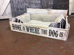 This is a large pallet dog bed taken from reclaimed wood and made into a wonderful cozy hideaway for your furry family member....and we dont mean Uncle Steve. Each bed is one of a kind, just as every piece of reclaimed wood is unique. This one is large enough for your one large dog or