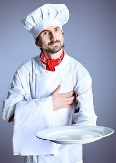 Serious Chef With Empty Plate