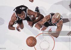 Aerial view of San Antonio Spurs David Robinson (50) and Dennis Rodman (10) in action, rebounding vs Portland Trail Blazers at Memorial Coliseum. Brian Drake