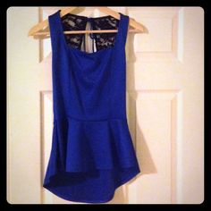 Peplum Top with Lace Back Super cute blue peplum top. The back is cut out and has lace straps. It's never been worn. The fabric is super smooth and soft but I'd say it's a little tight for a size M. Tops Blouses