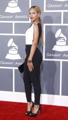 February 2013: Beyoncé switches things up and opts for a black-and-white Osman Yousefzada jumpsuit instead of a gown.