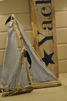 Driftwood sign and sailboats