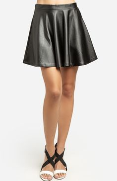 Summer Leatherette Circle Skirt  $34.99  Style #: 80231  Faux leather circle skirt with an exposed back zipper. Unlined. Colors: black, pink or beige