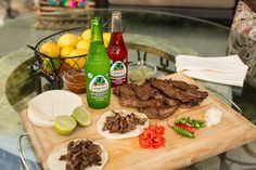 Jarritos Grapefruit and Strawberry with a fresh platter, tacos, meat, bbq, carne aside, mexican food, grill, grilled meat, mexican fiesta, mexican party, party ideas, cooking, steak, chilis, lime, soft tacos, tortillas, taquitos, mexican dishes, mexican cuisine, foodie,Jarritos, Soft Drink, Mexican Soda, Fruit Flavored Soda, Glass Bottle, Iconic Beverage, Soda Mixer, Soda in a Glass Bottle, Real Sugar, Cane Sugar, Made in Mexico, Mexico, Mexican, Natural Flavor Soda