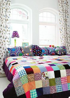Quilt + pillows + curtain on a crisp white background. Lovely!