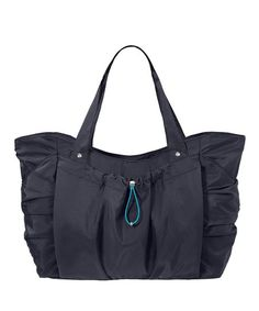 775372b0616 Keep your gym basics covered on the way to your workout with this  grab-and-go bag featuring a handy outer sleeve for yoga mat storage.