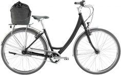 Bicicleta HERCULES City Lite Comp. Versión femenina, incluye parrilla Racktime I-Valo con luz LED integrada y el bolso Racktime Shop-it con sistema de anclaje Snap-it.