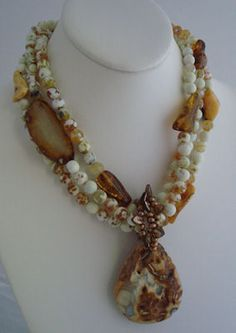 jewelry image of Three strands of faceted Fire Agate and Amber with an Agate Pendant with removable bail made with Fresh Water Pearls and Czech Glass. Necklace closed with a gold-filled toggle clasp.