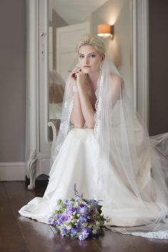Spellbinder...  A lace edged single tier veil in Italian tulle.