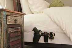 Wow!  like this.  Low profile piece of steel slides under mattress, bedding covers the gear. Gun holster, flashlight, pepper spray, handcuffs, etc. slides easily onto bar.  Found this at www.holstarr.com and it's made in here in the U.S.A.