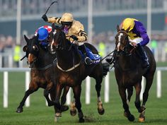 Left to right, The Giant Bolster, On His Own and the winner Lord Windermere in the Cheltenham Gold Cup.