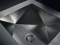 """The multifaceted Polyedro sink has architectural flair and fits in a 24"""" cabinet.  www.Franke.com"""