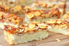 Bee Sting Bars Recipe:Based off a German cake called Bienenstich, these bars are made up of crumbly, buttery shortbread and an Amaretto-Honey Almond Topping.