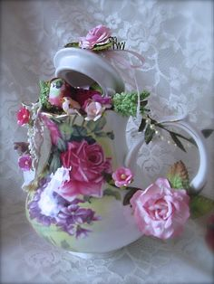 This shabby chic tea set was a overnight idea.  I used flowers, ribbon, pearls, mushroom birds, lace and other embellishments. Notice the ...