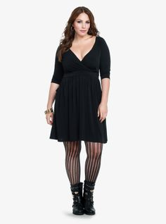 Soft and sexy, this knit LBD is all set to dress up your fall days and nights. We've perfected the flirty style with a flattering faux wrap neckline, shirring at the waist and functional skirt pockets.
