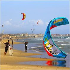 Windsurfing in TarifaIf (Spain). 'Andalucía has a hallmark outdoor  activity, it is windsurfing, a daring  white-knuckle sport given extra oomph by the stiff winds that enliven the choppy waters off the Straits of Gibraltar. The activity, along with its riskier sporting cousin, kiteboarding, has lent a hip vibe to the Costa de la Luz and its windy southern nexus Tarifa, a whitewashed coastal town that often feels more Moroccan than Spanish.' http://www.lonelyplanet.com/spain/andalucia/tarifa