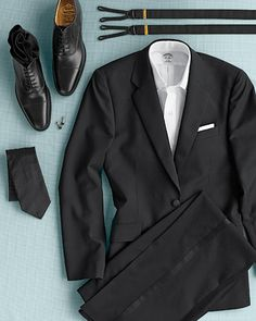 For a modern take on men's formalwear, have your groom skip the bow tie and rental tuxedo, and opt for a classic, single-breasted black suit and tie. Finish off with a crisp white dress shirt, cap-toe leather oxfords, suspenders, cuff links, and a pocket square, and, voila, the perfect wedding attire.
