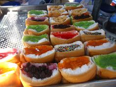 Khanom Pang Wan ขนมปังหวาน (Sweet Breads)    Not really Thai but a selection of hamburger buns filled with synthetic bright sweet things. Thai desserts sometimes take on interesting forms, shapes and flavors!