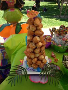 Donut hole tower for summer luau birthday party! Dessert table!