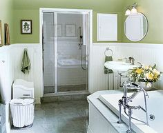 Pretty Green Bathroom With Subway Tile Shower And Wainscoting