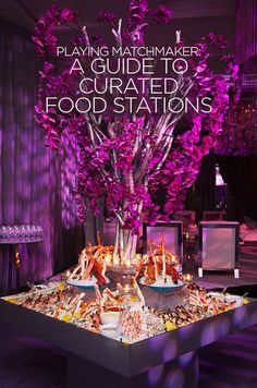 Purple phalaenopsis orchids hover over a raw bar filled with oysters, tiger prawns, Florida Stone Crabs and scallops.