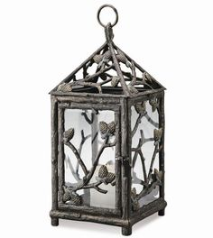 Metal candle lantern with pinecone and branch motif. Product: Lantern Construction Material: Aluminum and glass Color: Charcoal Features: Charming design Dimensions: 22 H x W x D Note: Candle not included Outdoor Hanging Lanterns, Garden Lanterns, Outdoor Ceiling Fans, Candle Lanterns, Outdoor Lighting, Candles, Exterior Lighting, Outdoor Decor, Mountain Cabin Decor